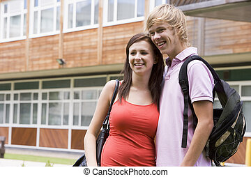 Happy young couple on campus