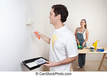 Happy young couple painting