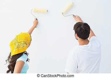 Happy young couple painting together