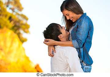 Happy young couple showing affection.