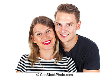 Happy young couple smiling at the camera