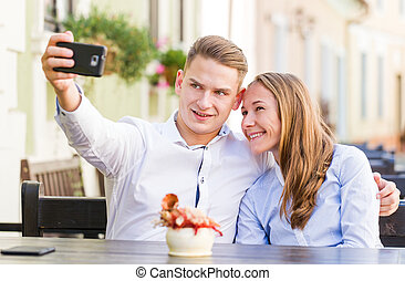 Happy young couple - Photo of happy young couple taking a...