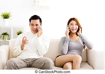 happy young  couple talking on the phones