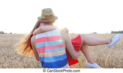 Happy young couple together in countryside having fun