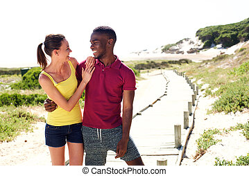 Happy young couple together outdoors on a summer day