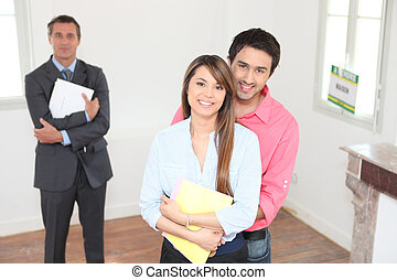 Happy young couple visiting house