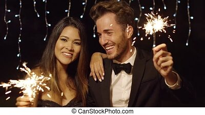 Happy young couple welcoming in the New Year - Happy stylish...
