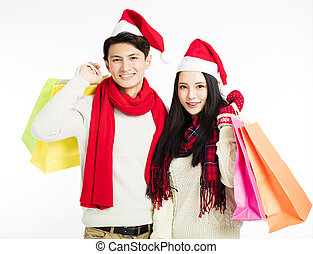 happy young couple with christmas shopping