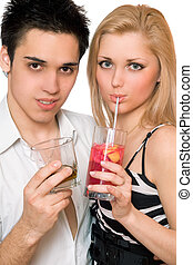 Happy young couple with cocktails. Isolated