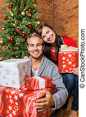 Happy Young Couple with Gift Boxes