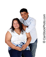 Happy young East Indian couple smiling