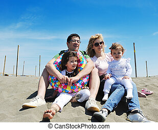 happy young family have fun on beach