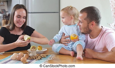 Happy young family having breakfast in the kitchen....