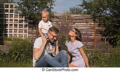 Happy Young Family Having Fun Outdoors.