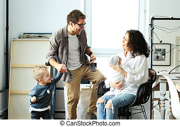 Happy young family laughing and dancing