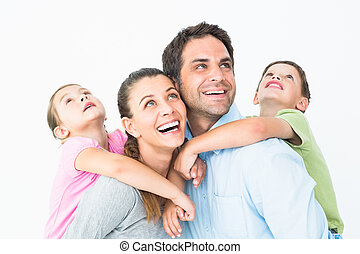 Happy young family looking up together