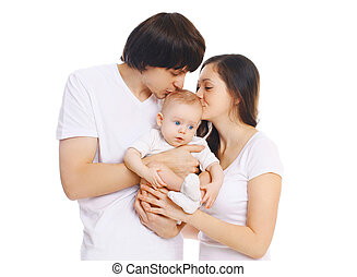 Happy young family, mother and father kissing baby on white background