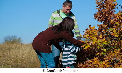 Happy Young Family Near Autumn Bush