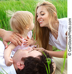 Happy young family outdoors