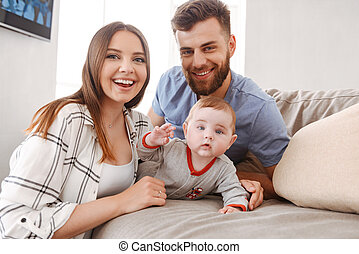 Happy young family. Parents having fun with their little child