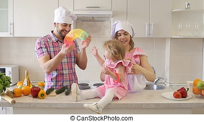 Happy Young Family Spending Time in The Kitchen.