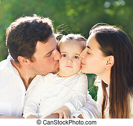 Happy young family with baby girl