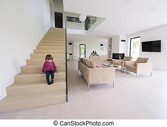 family with little girl enjoys in the modern living room