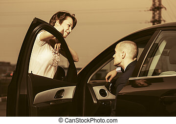Happy young fashion couple in a car