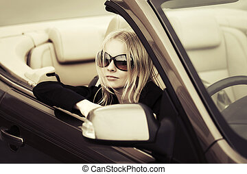 Happy young fashion woman in the convertible car