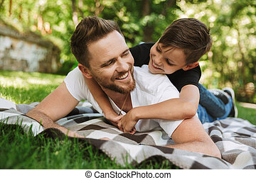 Happy young father have fun with his little son