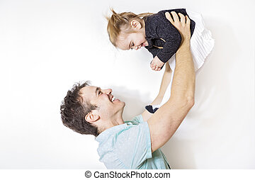 Happy young father playing with little daughter