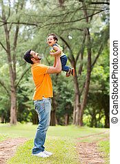 happy young father playing with son
