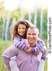 Happy young father with daughter outdoors