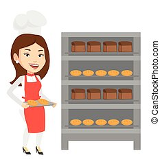 Happy young female baker holding tray of bread.