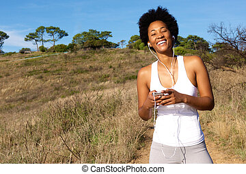 Happy young female runner having break
