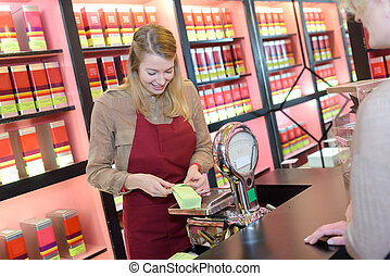 happy young female seller in pharmaceutical store