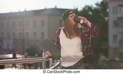 Happy Young female student dressed in casual clothing with ...