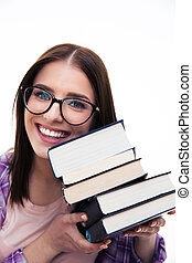 Happy young female student with books