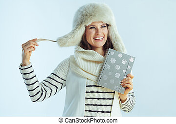 happy young female with notebook looking at copy space