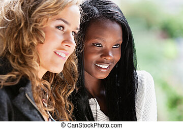 Happy young females looking away