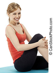 happy young fitness woman making a pause on white background