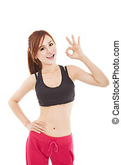 happy young fitness woman with ok gesture