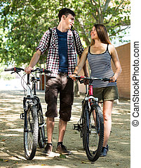 friends in casual clothes cycling