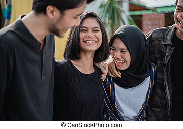 happy young friends laughing together