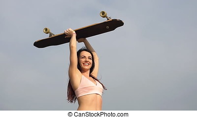 Happy young girl and longboard outdoor, Slow motion.