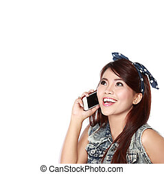 Happy young girl calling by phone