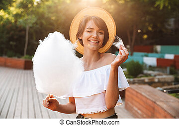 Happy young girl dressed in summer clothes