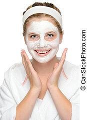 Happy young girl face mask smiling cosmetics cleaning cream