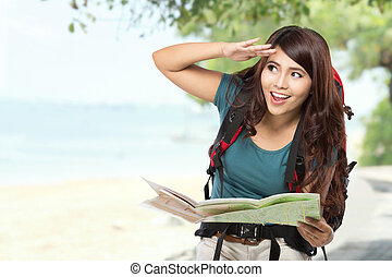 Happy young girl going on vacation with backpack and map