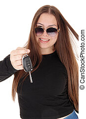 Happy young girl got a new car showing the keys